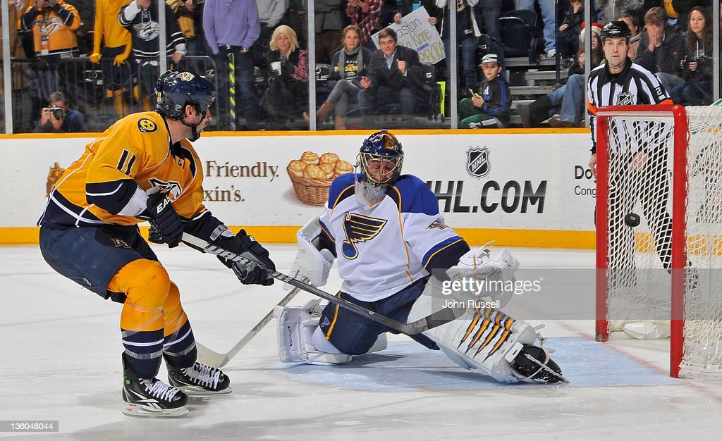 <a gi-track='captionPersonalityLinkClicked' href=/galleries/search?phrase=David+Legwand&family=editorial&specificpeople=202553 ng-click='$event.stopPropagation()'>David Legwand</a> #11 of the Nashville Predators scores the overtime shootout game winner against goalie <a gi-track='captionPersonalityLinkClicked' href=/galleries/search?phrase=Jaroslav+Halak&family=editorial&specificpeople=2285591 ng-click='$event.stopPropagation()'>Jaroslav Halak</a> #41 of the St. Louis Blues during an NHL game at the Bridgestone Arena on December 17, 2011 in Nashville, Tennessee.