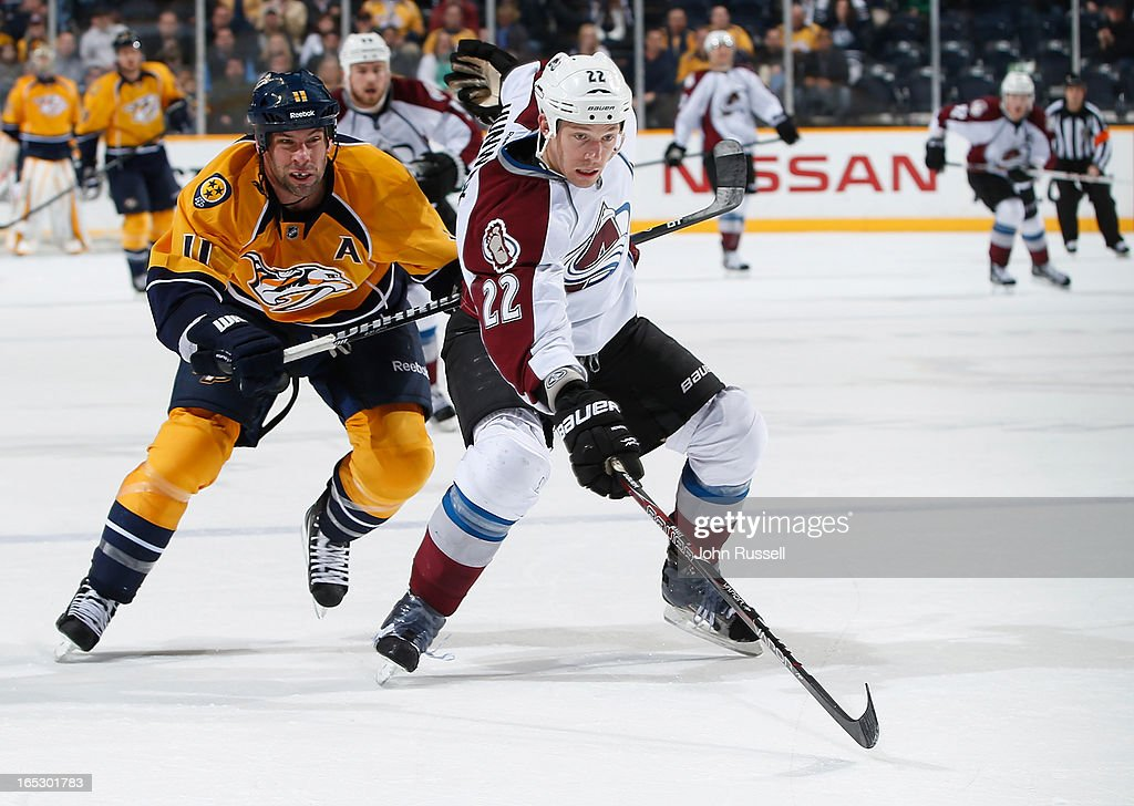 <a gi-track='captionPersonalityLinkClicked' href=/galleries/search?phrase=David+Legwand&family=editorial&specificpeople=202553 ng-click='$event.stopPropagation()'>David Legwand</a> #11 of the Nashville Predators skates for the puck against <a gi-track='captionPersonalityLinkClicked' href=/galleries/search?phrase=Matt+Hunwick&family=editorial&specificpeople=2284766 ng-click='$event.stopPropagation()'>Matt Hunwick</a> #22 of the Colorado Avalanche during an NHL game at the Bridgestone Arena on April 2, 2013 in Nashville, Tennessee.