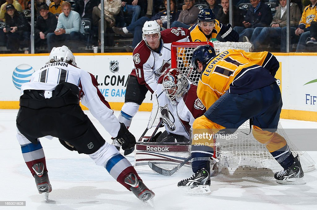 <a gi-track='captionPersonalityLinkClicked' href=/galleries/search?phrase=David+Legwand&family=editorial&specificpeople=202553 ng-click='$event.stopPropagation()'>David Legwand</a> #11 of the Nashville Predators slides the puck in the net against <a gi-track='captionPersonalityLinkClicked' href=/galleries/search?phrase=Jean-Sebastien+Giguere&family=editorial&specificpeople=202814 ng-click='$event.stopPropagation()'>Jean-Sebastien Giguere</a> #35 of the Colorado Avalanche during an NHL game at the Bridgestone Arena on April 2, 2013 in Nashville, Tennessee.