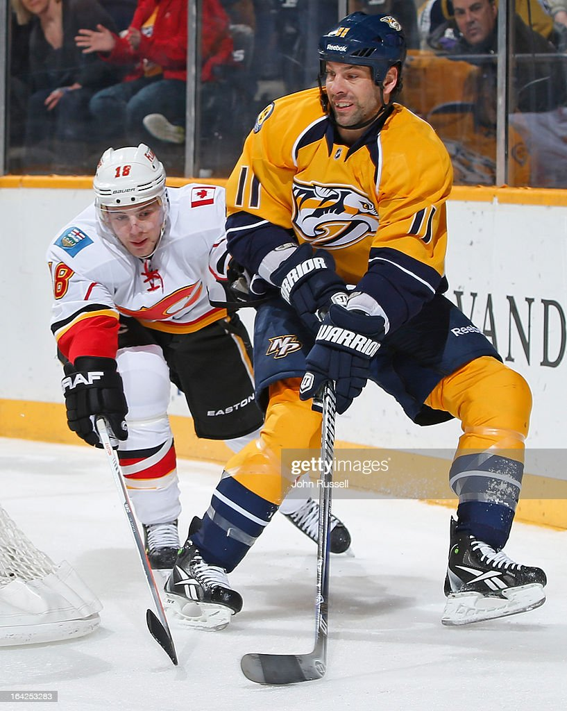 <a gi-track='captionPersonalityLinkClicked' href=/galleries/search?phrase=David+Legwand&family=editorial&specificpeople=202553 ng-click='$event.stopPropagation()'>David Legwand</a> #11 of the Nashville Predators tries to center puck against Matt Stajan #18 of the Calgary Flames during an NHL game at the Bridgestone Arena on March 21, 2013 in Nashville, Tennessee.