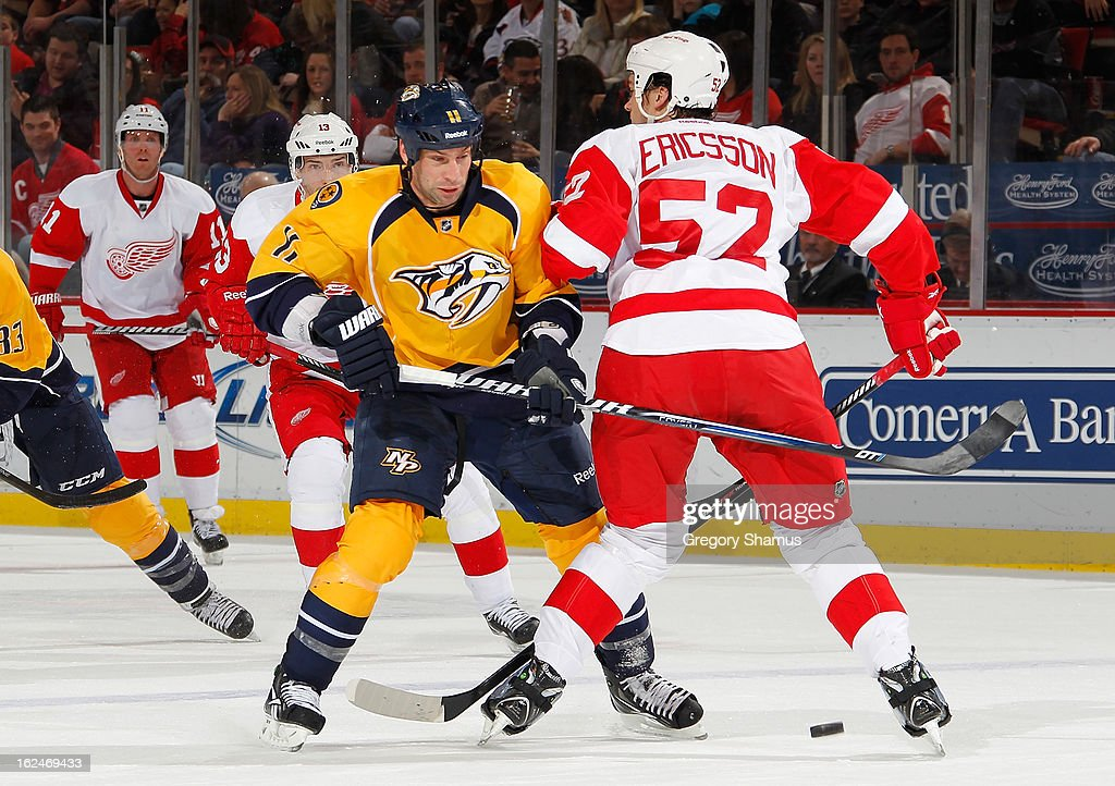 David Legwand #11 of the Nashville Predators tries to get around the defense of Jonathan Ericsson #52 of the Detroit Red Wings during the second period at Joe Louis Arena on February 23, 2013 in Detroit, Michigan.