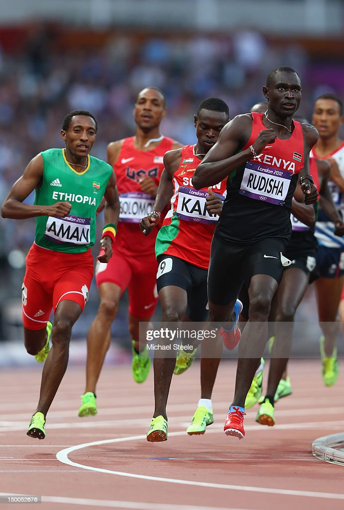 David Lekuta (R) Rudisha of Kenya rounds a bend ahead of (L-R) <a gi-track='captionPersonalityLinkClicked' href=/galleries/search?phrase=Mohammed+Aman&family=editorial&specificpeople=7149144 ng-click='$event.stopPropagation()'>Mohammed Aman</a> of Ethiopia, <a gi-track='captionPersonalityLinkClicked' href=/galleries/search?phrase=Duane+Solomon&family=editorial&specificpeople=2337026 ng-click='$event.stopPropagation()'>Duane Solomon</a> of the United States and <a gi-track='captionPersonalityLinkClicked' href=/galleries/search?phrase=Abubaker+Kaki&family=editorial&specificpeople=4900120 ng-click='$event.stopPropagation()'>Abubaker Kaki</a> of Sudan on his way to winning gold and setting a new world record of 1.40.91 in the Men's 800m Final on Day 13 of the London 2012 Olympic Games at Olympic Stadium on August 9, 2012 in London, England.