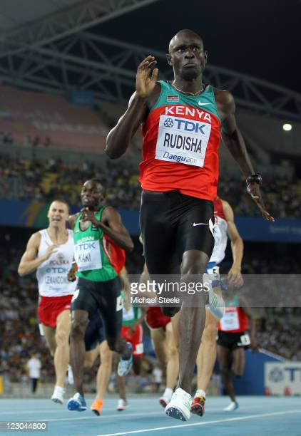 David Lekuta Rudisha of Kenya sprints for the finish line to claim gold ahead of Marcin Lewandowski of Poland and Abubaker Kaki of Sudan in the men's...
