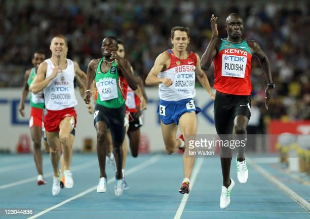David Lekuta Rudisha of Kenya sprints for the finish line to claim gold ahead of Marcin Lewandowski of Poland Abubaker Kaki of Sudan and Yuriy...