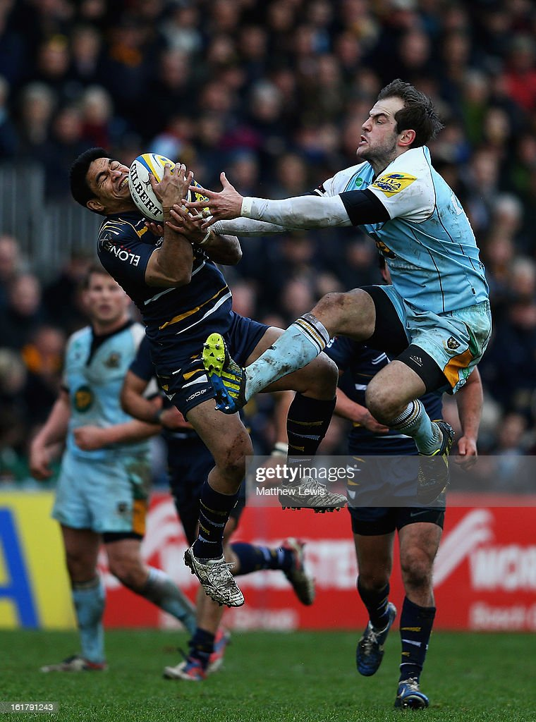 David Lemi of Worcester and Stephen Myler of Northampton challenge for the high ball during the Aviva Premiership match between Worcester Warriors and Northampton Saints at Sixways Stadium on February 16, 2013 in Worcester, England.