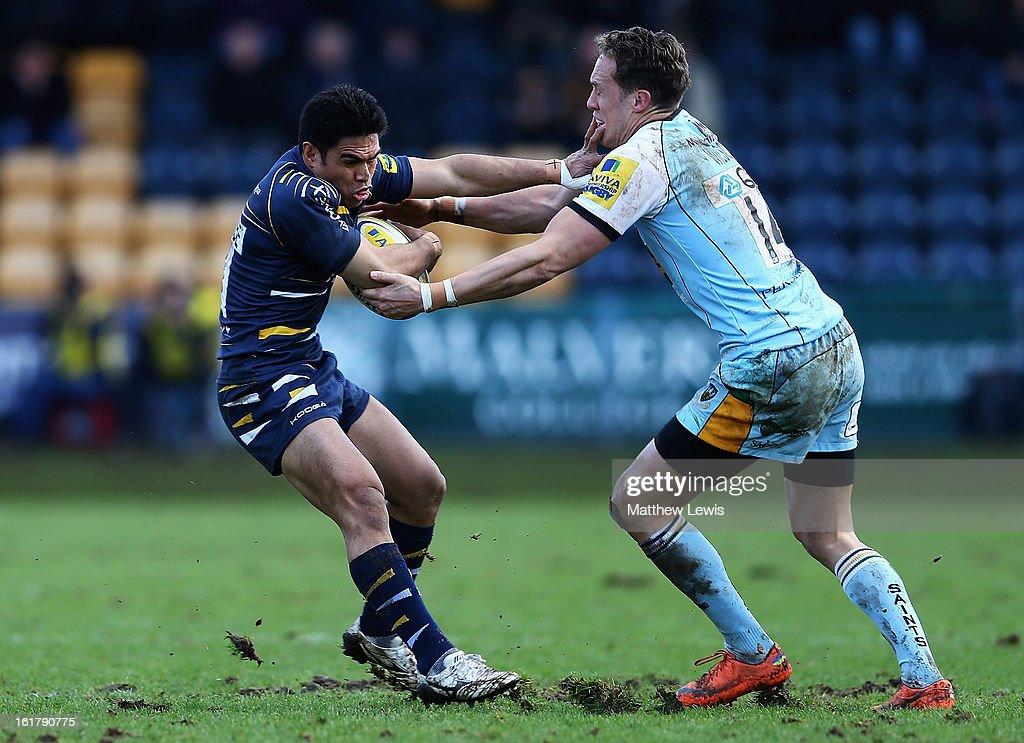 David Lemi of Worcester is caught by James Wilson of Northampton during the Aviva Premiership match between Worcester Warriors and Northampton Saints at Sixways Stadium on February 16, 2013 in Worcester, England.