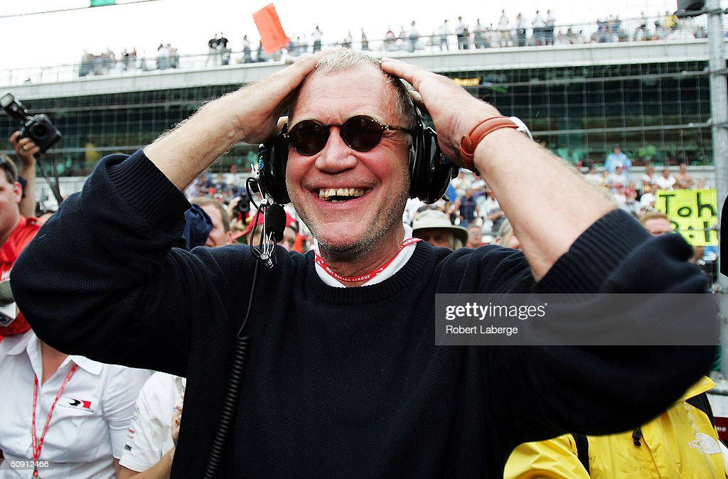 David Letterman, co-owner of the #15 Rahal-Letterman Argent/Pioneer G Force Honda of Buddy Rice smiles when the rains started to fall to cause the race to be shortened and win the 88th running of the Indianapolis 500 part of the IRL IndyCar Series on May 30, 2004 at the Indianapolis Motor Speedway in Indianapolis, Indiana.