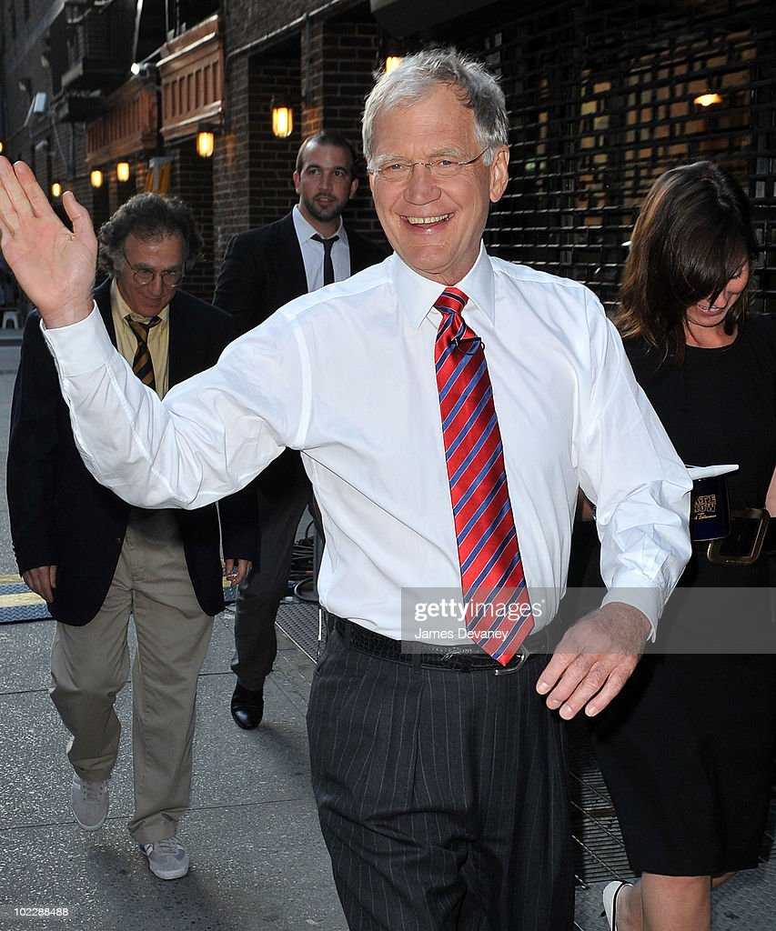 David Letterman greets fans outside 'Late Show With David Letterman' at the Ed Sullivan Theater on June 21, 2010 in New York City.