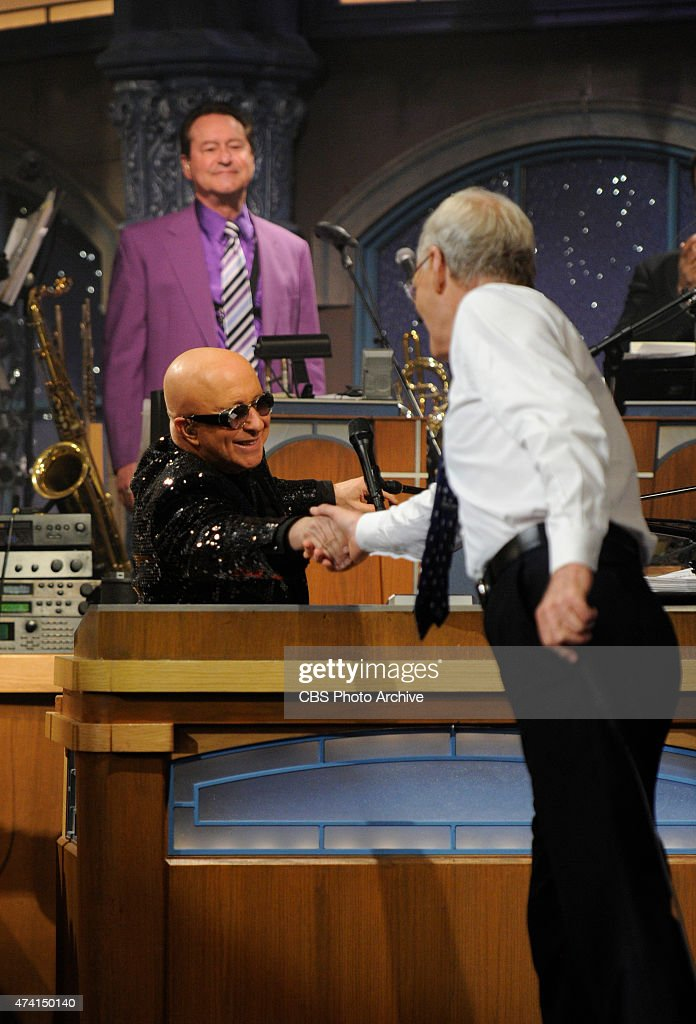 David Letterman shakes hands with Paul Shaffer after the final taping of the Late Show with David Letterman, Wednesday May 20, 2015 on the CBS Television Network. After 33 years in late night television, 6,028 broadcasts, nearly 20,000 total guest appearances, 16 Emmy Awards and more than 4,600 career Top Ten Lists, David Letterman says goodbye to late night television audiences. The show was taped Wednesday at the Ed Sullivan Theater in New York.