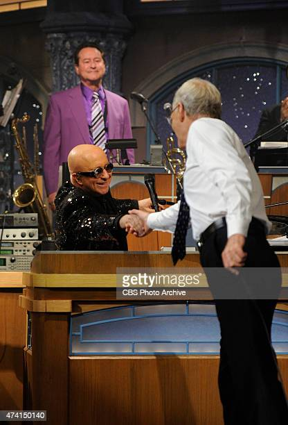 David Letterman shakes hands with Paul Shaffer after the final taping of the Late Show with David Letterman Wednesday May 20 2015 on the CBS...
