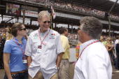 David Letterman with assistant Stephanie Birkitt talks to Mario Andretti before the start of the Indy 500 on May 27 2007 in Speedway Indiana