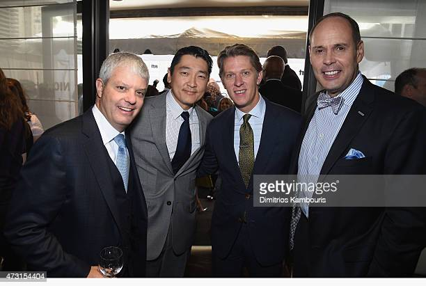 David Levy President TBS Inc Stephano Kim John Martin Chairman Chief Executive Officer TBS Inc and Ernie Johnson Jr attend the Turner Upfront 2015 at...