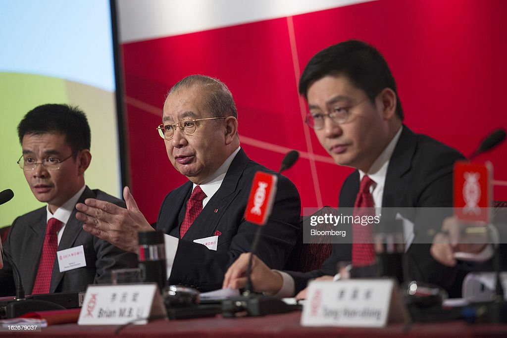 David Li, chairman and chief executive officer of Bank of East Asia Ltd. (BEA), center, speaks as Adrian Li, deputy chief executive officer, left, and Brian Li, deputy chief executive officer, look on during the company's annual results news conference in Hong Kong, China, on Tuesday, Feb. 26, 2013. Bank of East Asia, Hong Kong's largest family-run lender, said 2012 profit jumped 39 percent as trading income climbed, helping offset a decline in profit from the mainland China business. Photographer: Jerome Favre/Bloomberg via Getty Images