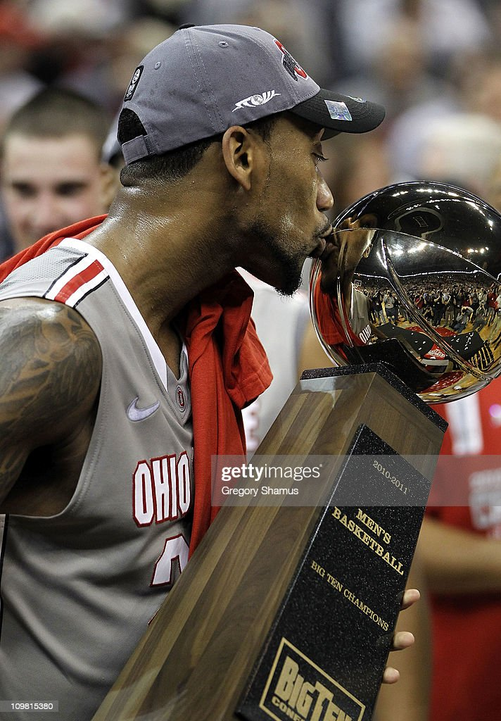 David Lighty of the Ohio State Buckeyes kisses the Big Ten trophy after beating the Wisconsin Badgers 9365 on March 6 2011 at the Value City Arena in...