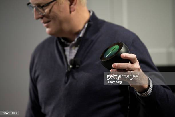 David Limp senior vice president of devices and services at Amazoncom Inc holds the new Echo Spot device during the company's product reveal launch...