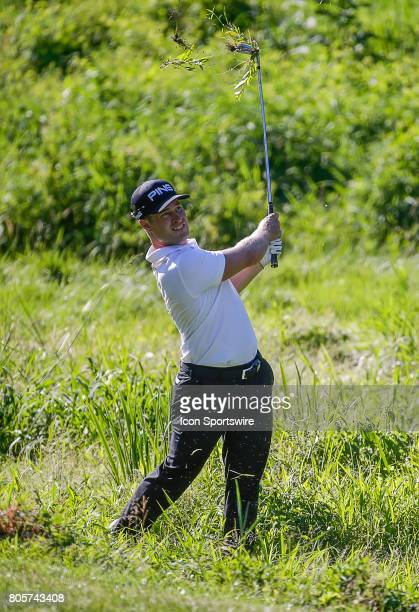 David Lingmerth hits out of the much along the left side of the 10th fairway during the third round of the Quicken Loans National on July 01 2017 at...