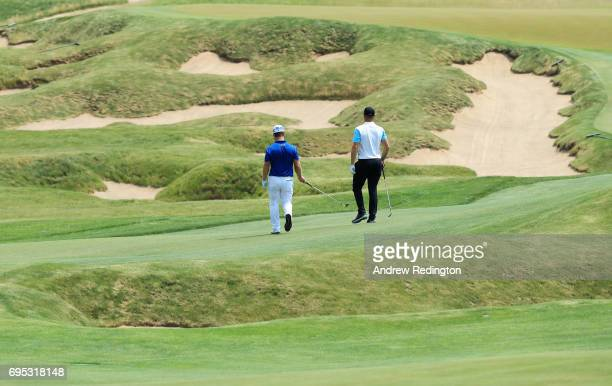 David Lingmerth of Sweden and Alexander Noren of Sweden walk on the 18th hole during a practice round prior to the 2017 US Open at Erin Hills on June...