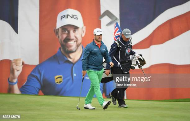 David Lingmerth of Sweden and his caddie walk on the 18th green during day three of the British Masters at Close House Golf Club on September 30 2017...