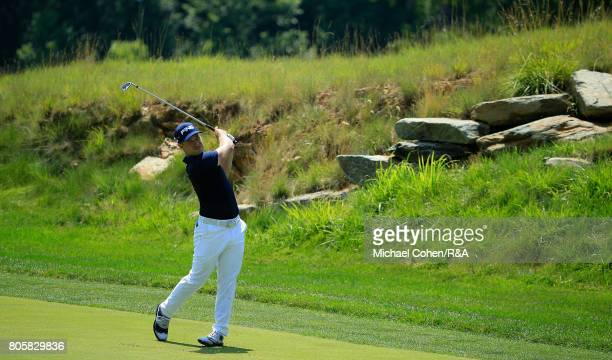 David Lingmerth of Sweden hits his third shot on the second hole during the fourth and final round of the Quicken Loans National held at TPC Potomac...