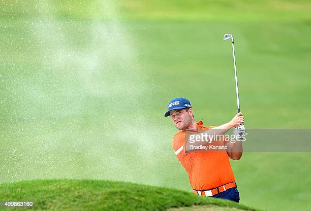 David Lingmerth of Sweden plays a shot out of the bunker on the 13th hole during day two of the 2015 Australian PGA Championship at Royal Pines...