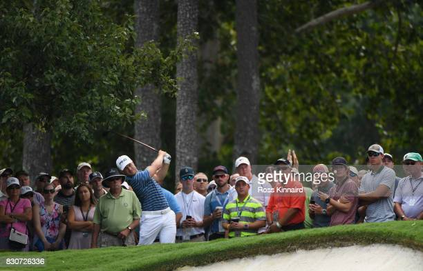 David Lingmerth of Sweden plays his second shot on the first hole during the third round of the 2017 PGA Championship at Quail Hollow Club on August...