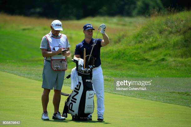 David Lingmerth of Sweden prepares to hit his third shot on the second hole during the fourth and final round of the Quicken Loans National held at...