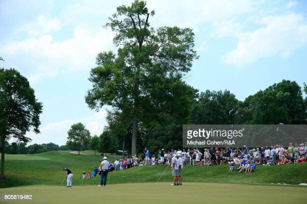 David Lingmerth of Sweden strokes a putt for birdie on the ninth green during the fourth and final round of the Quicken Loans National held at TPC...