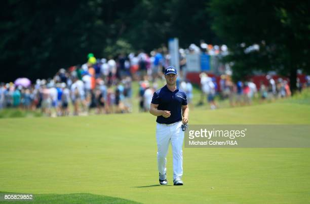 David Lingmerth of Sweden walks the first fairway during the fourth and final round of the Quicken Loans National held at TPC Potomac at Avenel Farm...