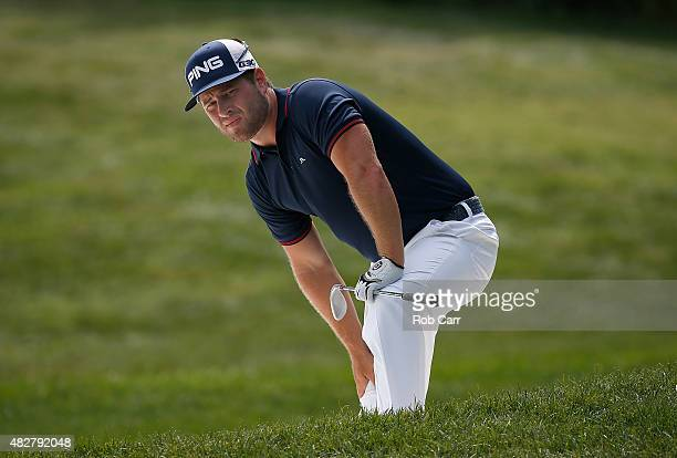 David Lingmerth of Sweden watches his ball after a shot from a sand trap on the eighth hole during the final round of the Quicken Loans National at...