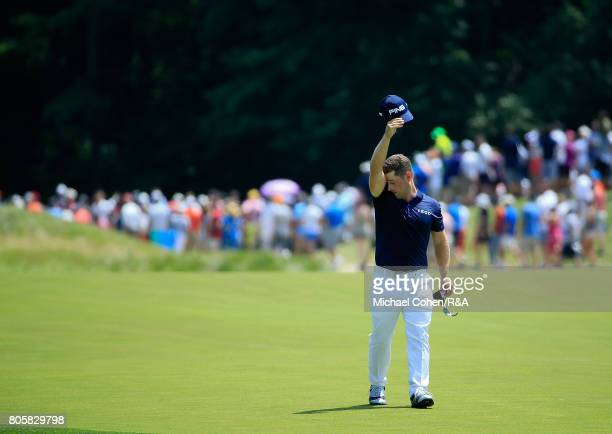 David Lingmerth of Sweden wipes his brow as he walks the first fairway during the fourth and final round of the Quicken Loans National held at TPC...