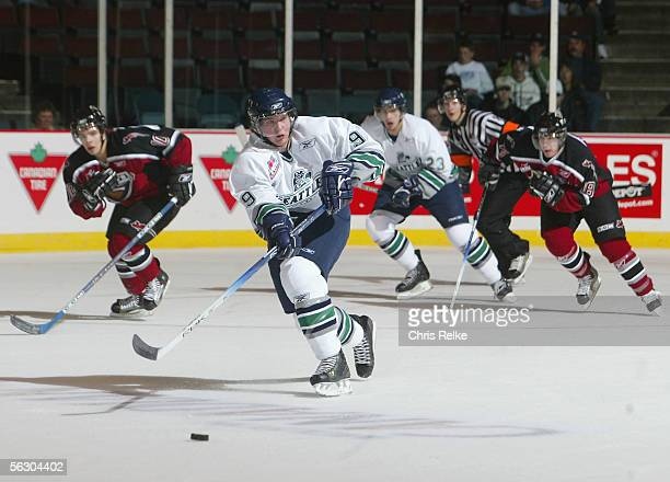 David Linsley of the Seattle Thunderbirds passes the puck against the Vancouver Giants during the WHL hockey game on October 2 2005 at Pacific...