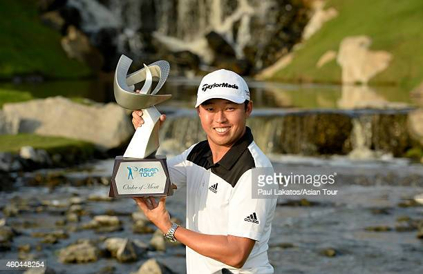 David Lipsky of the USA pictured with the Asian Tour Order of Merit trophy during round four of the Thailand Golf Championship at Amata Spring...
