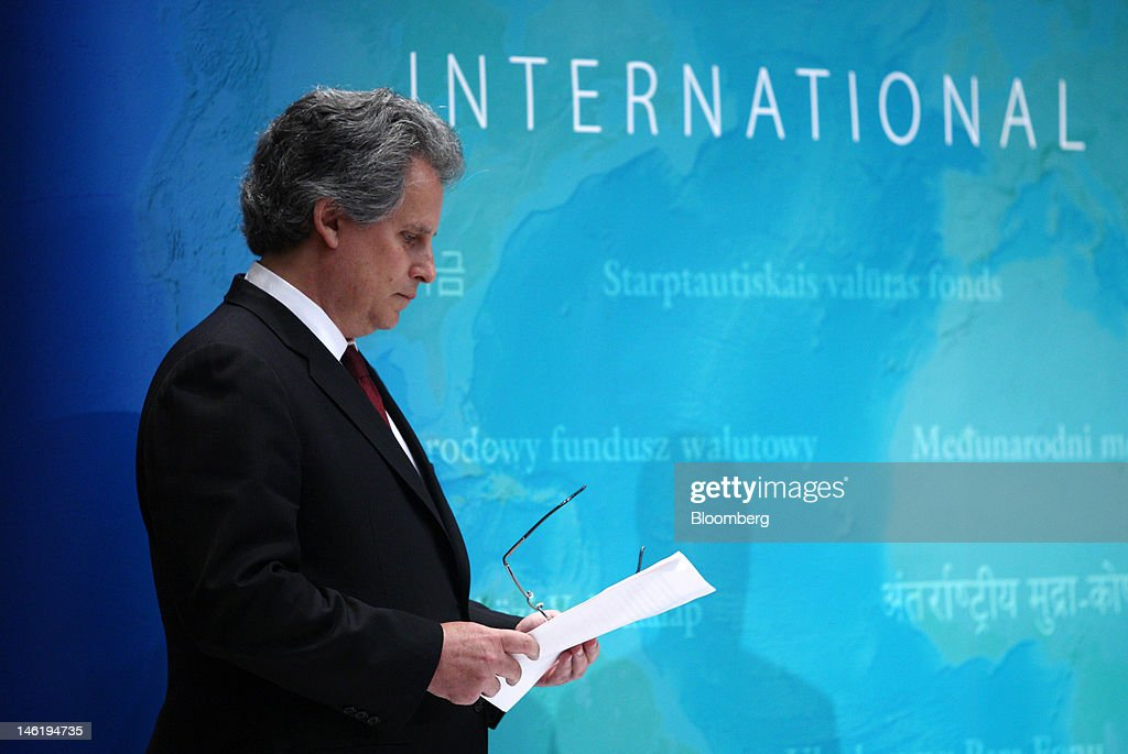 David Lipton first deputy managing director of the International Monetary Fund reads a paper during a news conference in Tokyo Japan on Tuesday June...