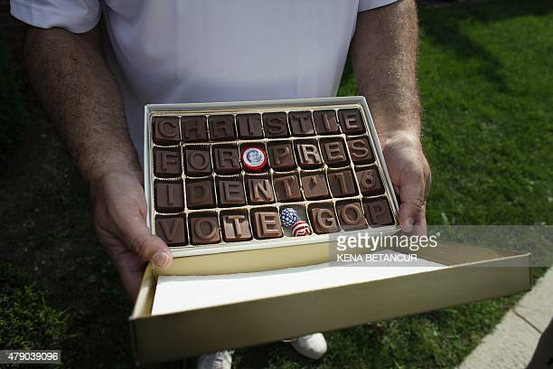 David Little displays a box of Chocolates showing his support for New Jersey Governor Chris Christie as he waits outside Livingston High School In...