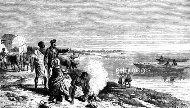 David Livingstone Scottish missionary and African explorer with members of his expedition and his wife and family discovering Lake Ngami Botswana on...