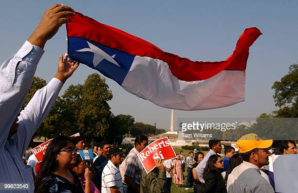 David Llancao holds a Chilean flag during a rally on the West Front held by the National Coalition of Latino Clergy and Christian Leaders in support...
