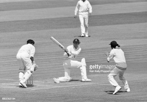David Lloyd of England sweeps a delivery past India's wicketkeeper Farokh Engineer during his innings of 214 not out in the 3rd Test match between...