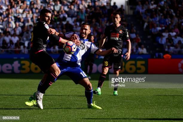 David Lopez midfielder of RCD Espanol battles for the ball with Florin Andone forward of Deportivo de La Coruna during the La Liga Santander match...