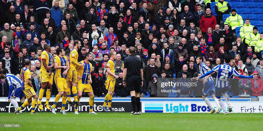 David Lopez of Brighton (R) guides his free kick over the Crystal Palace wall and in to the net during the npower Championship match between Brighton & Hove Albion and Crystal Palace at Amex Stadium on March 17, 2013 in Brighton, England.
