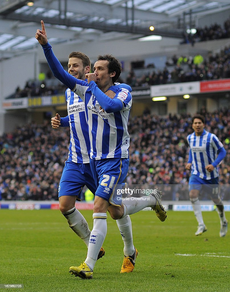 David Lopez of Brighton & Hove Albion celebrates scoring a penalty and the teams fourth with Andrea Orlandi during the npower Championship match between Brighton & Hove Albion and Huddersfield Town at The Amex Stadium on March 02, 2013 in Brighton England.
