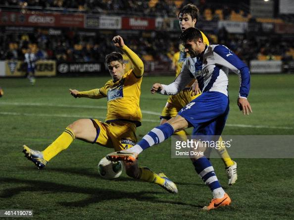David Lopez of Espanyol gets his shot on goal blocked by Hector Verdes of AD Alcorcon during the Copa del Rey Round of 16 1st leg match between...