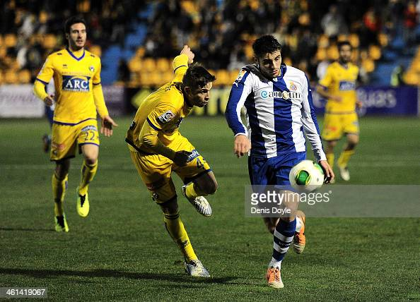 David Lopez of RCD Espanyol shileds the ball from Hector Verdes of AD Alcorcon during the Copa del Rey Round of 16 1st leg match between Alcorcon and...