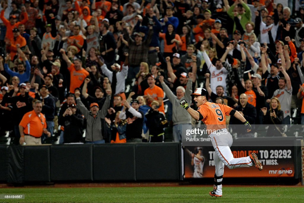 <a gi-track='captionPersonalityLinkClicked' href=/galleries/search?phrase=David+Lough&family=editorial&specificpeople=6780100 ng-click='$event.stopPropagation()'>David Lough</a> #9 of the Baltimore Orioles celebrates as he hits the game-winning RBI single to score teammate Stephen Lombardozzi against the Toronto Blue Jays in the twelfth inning at Oriole Park at Camden Yards on April 12, 2014 in Baltimore, Maryland. The Baltimore Orioles won, 2-1, in the twelfth inning.