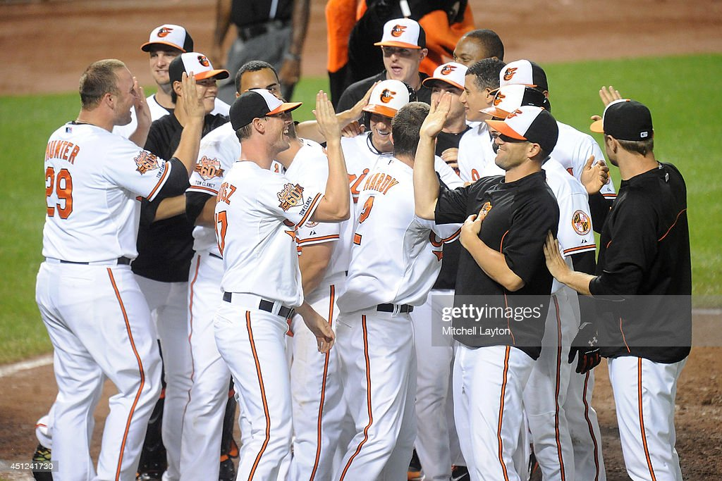 <a gi-track='captionPersonalityLinkClicked' href=/galleries/search?phrase=David+Lough&family=editorial&specificpeople=6780100 ng-click='$event.stopPropagation()'>David Lough</a> #9 of the Baltimore Orioles celebrates scoring on a walk off wild pitch by Daniel Webb #40 of the Chicago White Sox (not pictured) in the 12th inning during a baseball game on June 25, 2014 at Oriole Park at Camden Yards in Baltimore, Maryland. The Oriole swon 5-4 in the 12th inning.