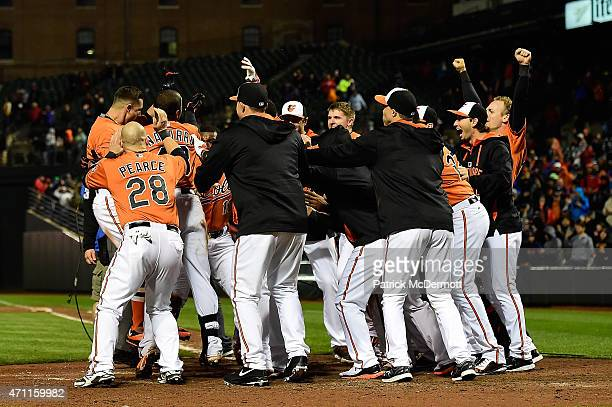 David Lough of the Baltimore Orioles celebrates with his teammates after hitting the game winning walkoff home run in the 10th inning against the...