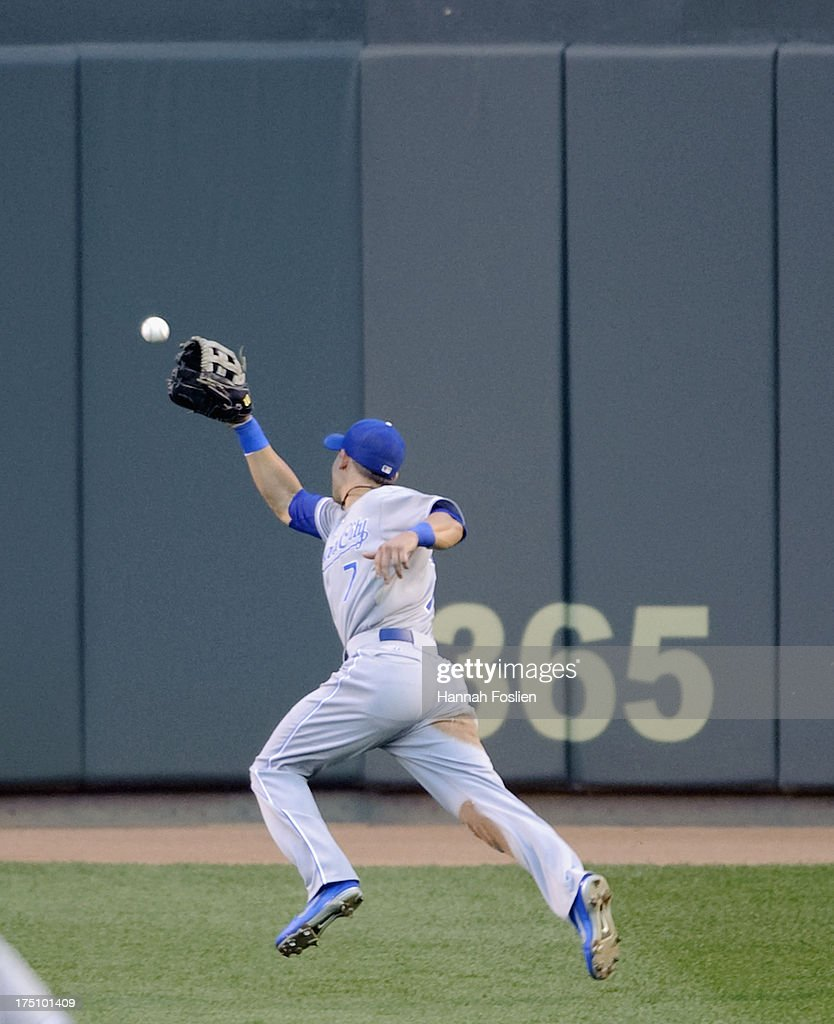 <a gi-track='captionPersonalityLinkClicked' href=/galleries/search?phrase=David+Lough&family=editorial&specificpeople=6780100 ng-click='$event.stopPropagation()'>David Lough</a> #7 of the Kansas City Royals misses a catch of the double hit by Clete Thomas #11 of the Minnesota Twins during the third inning of the game on July 31, 2013 at Target Field in Minneapolis, Minnesota.
