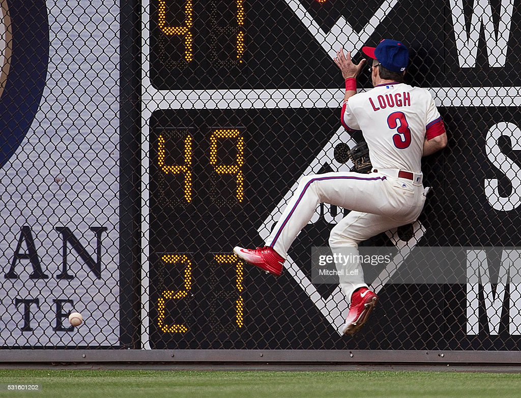 <a gi-track='captionPersonalityLinkClicked' href=/galleries/search?phrase=David+Lough&family=editorial&specificpeople=6780100 ng-click='$event.stopPropagation()'>David Lough</a> #3 of the Philadelphia Phillies hits the wall trying to catch a ball hit by Jay Bruce #32 of the Cincinnati Reds in the top of the second inning at Citizens Bank Park on May 15, 2016 in Philadelphia, Pennsylvania.