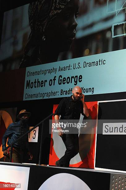 David Lowery and Dosunmu accept on behalf of Bradford Young the Winner of the Cinematography Award US Dramatic for Mother of George onstage at the...