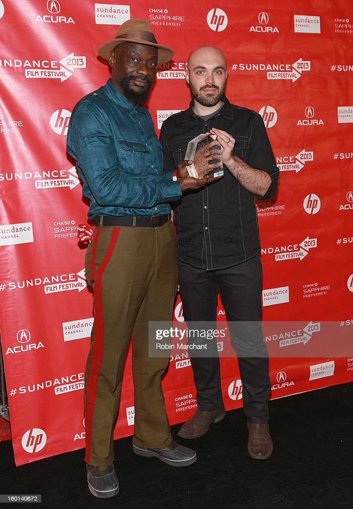 David Lowery and Dosunmu poses with award accepted on behalf of Bradford Young the Winner of the Cinematography Award: U.S. Dramatic for Mother of George at the Awards Night Ceremony during the 2013 Sundance Film Festival at Basin Recreation Field House on January 26, 2013 in Park City, Utah.
