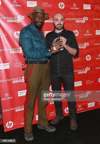 David Lowery and Dosunmu poses with award accepted on behalf of Bradford Young the Winner of the Cinematography Award US Dramatic for Mother of...